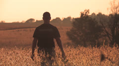 Soybean farmer walks in his field Stock Footage