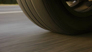 Stock Video Footage of Car wheel rolling - Close Up.