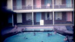 1950s 8mm film Motel Sands Kids Playing in the Pool Stock Footage