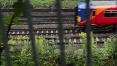 Tracking shot of suburban train - stock footage