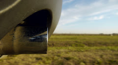 Exhaust close up, driving a car on a country road. Day. Stock Footage