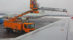 Stock Video Footage of processing aircraft anti-icing in airport