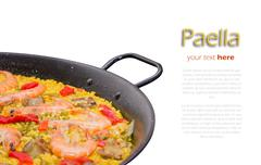detail of traditional spanish paella cooked in a pan - stock photo
