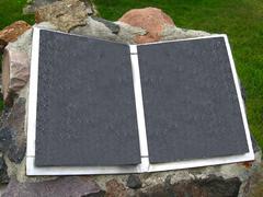 Stone book on front garden Stock Photos