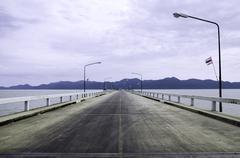 straight road along the sea - stock photo