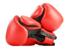 Pair of red leather boxing gloves isolated on white Stock Photos