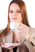 portrait of a beautiful businesswoman with a cup of coffe isolated on white b - stock photo