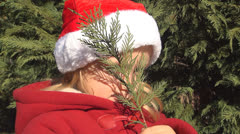 Portrait of a Smiling Child Smelling a Fir Tree, Girl in Christmas Cap, Children Stock Footage