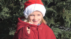 Portrait of a Smiling Child with Fireworks, Girl in Christmas Cap, Children Stock Footage