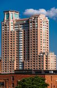 large apartment building, seen from federal hill in baltimore, maryland. - stock photo