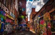 Stock Photo of sunny summer day in the graffiti alley, baltimore, maryland.
