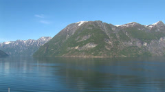 Sailing through the fjords of Norway on a sunny summer day Stock Footage