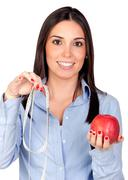Beautiful girl with a red apple and tape-measure Stock Photos