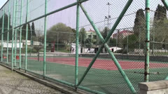 Empty tennis court panning Stock Footage