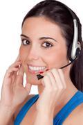 attractive teleoperator with headphones - stock photo