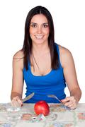 attractive girl eating a apple - stock photo