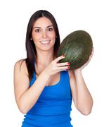 Stock Photo of beautiful girl with a green melon