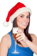 beautiful girl with christmas hat providing - stock photo