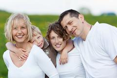 Family embracing each other Stock Photos