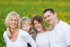Happy family walking outside Stock Photos