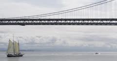 Ultra HD 4K Oakland Bay Bridge San Francisco Skyline, Sailing Boat Passing Stock Footage