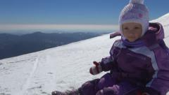 Child Playing in Snow in Mountains, Little Girl in Alpine Area, Winter, Children Stock Footage