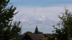 Clouds behind Houses Timelap Stock Footage