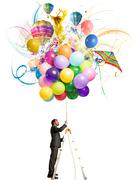 creative businessman with colorful balloon explosion - stock photo