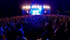 Crowd at a rock concert, back light silhouette - stock footage