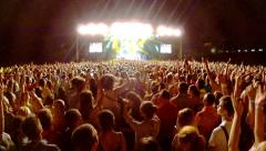 Crowd at a rock concert, back light silhouette Stock Footage