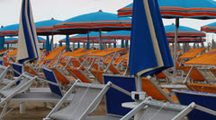 Empty sunbeds and parasols Stock Footage