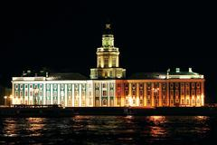 night photo of kunstkamery illuminated a building in the city of s-peterburge - stock photo