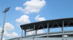 Timelapse,clouds move or running over outdoor roof of sport stadium Stock Footage