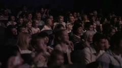 Children watching a show at the theatre 1. Stock Footage