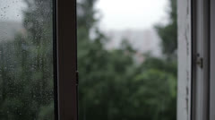 Heavy rain. Focus pulling from window to the building. Stock Footage