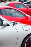 sports cars parked in a row - stock photo