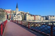 Stock Photo of famous view of saone river and red footbridge in lyon city