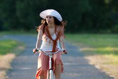 retro girl on old bike - stock photo