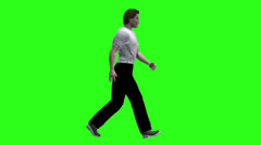 Profile of man walking green screen - stock footage