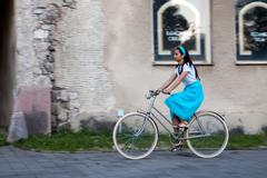 Retro girl on old bike Stock Photos