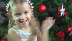 Child Clapping Hands, Applauding, Girl at Christmas Tree, Celebrating Children - stock footage