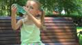 Thirsty Girl Drinking Water on Bench in Park, Little Child Resting, Children Footage