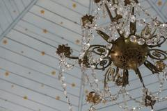 Painted star ceiling with chandelier detail - stock photo