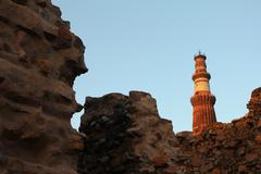 qutub minar and walls - stock photo