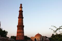 Qutub minar with other structures Stock Photos