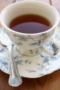 Tea in a china cup Stock Photos