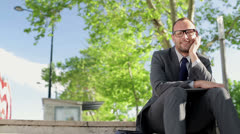 Portrait of young happy businessman in the city HD Stock Footage