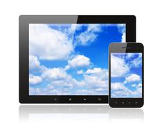 tablet pc and smart phone with blue sky - stock photo