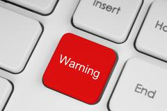 Red warning button on the keyboard Stock Photos