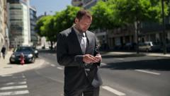 Young businessman waiting for someone in the city HD - stock footage